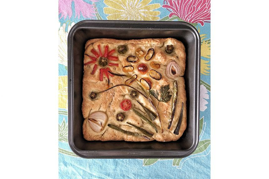 Let your imagination run wild when decorating your garden focaccia and allow for shrinkage in the oven.