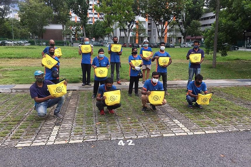 Cleaners from Bishan-Toa Payoh GRC with their Raya Kindness Packs. The packs, containing items like festive cookies and a thermal bag, were also given to cleaners in Tanjong Pagar GRC and Jalan Besar GRC.