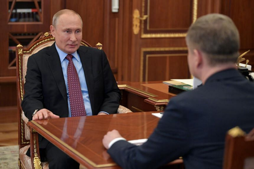Russia's President Vladimir Putin (left) attends a meeting at the Kremlin in Moscow, on May 25, 2020.