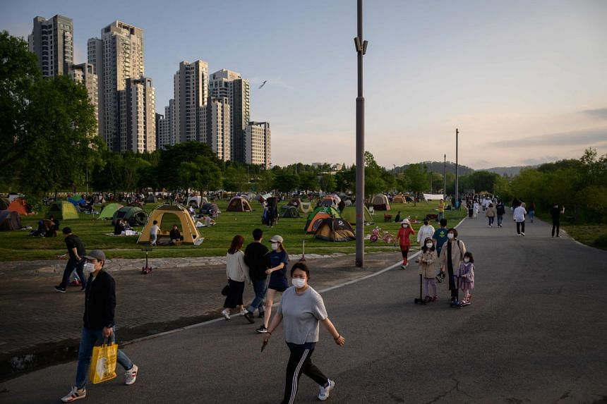 Life in South Korea is returning largely to normal and hundreds of thousands of pupils have gone back to school.