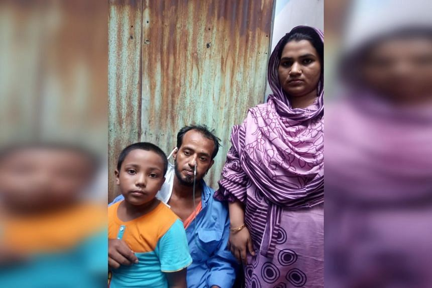 Mr Sikdar Rana at home in Dhaka with his wife Moshumi Akhter, 27, and their six-year-old son Mahim.