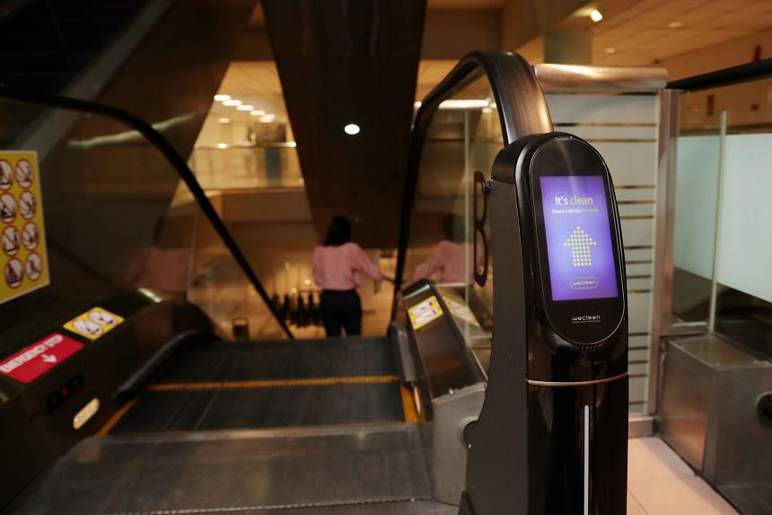 WeClean, an automated escalator handrail cleaning device, was installed at KK Women's and Children's Hospital last Friday. The device was installed at one escalator and will remain for a month to assess its effectiveness. ST PHOTO: GIN TAY