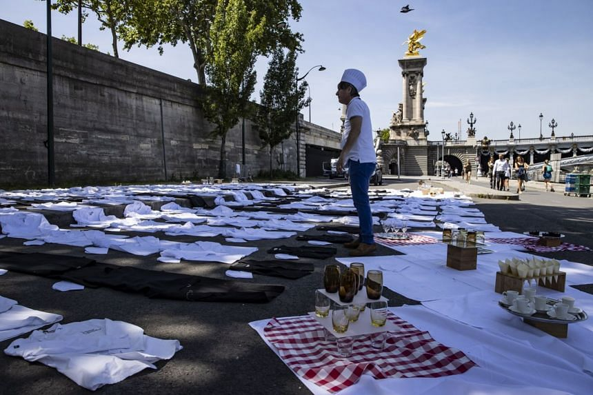 Chef's aprons are layed out on the banks of Paris' Seine river as part of a national protest.