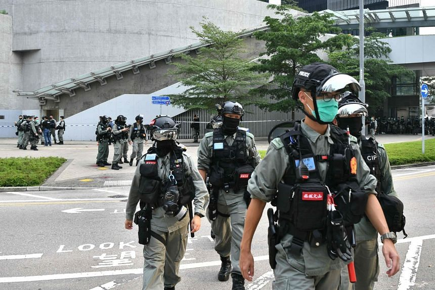 Riot police patrol outside the Legislative Council ahead of a debate over a law that bans insulting China's national anthem on May 27, 2020.