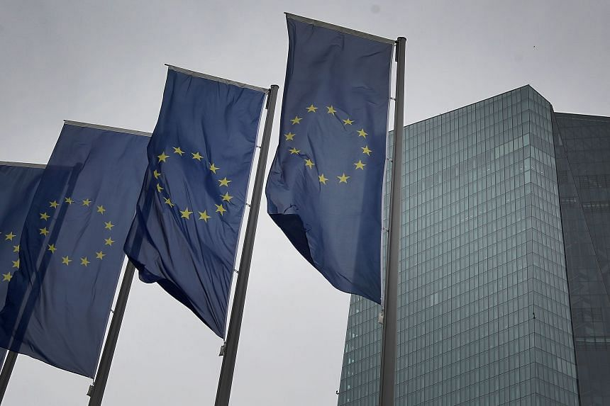 Flags of the European Union flutter in front of the headquarters of the European Central Bank in Germany on March 12, 2020.