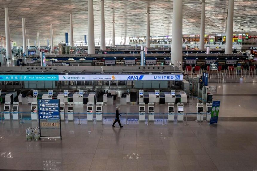 China reduced the number of international flights due to concerns about infections brought in by arriving passengers.