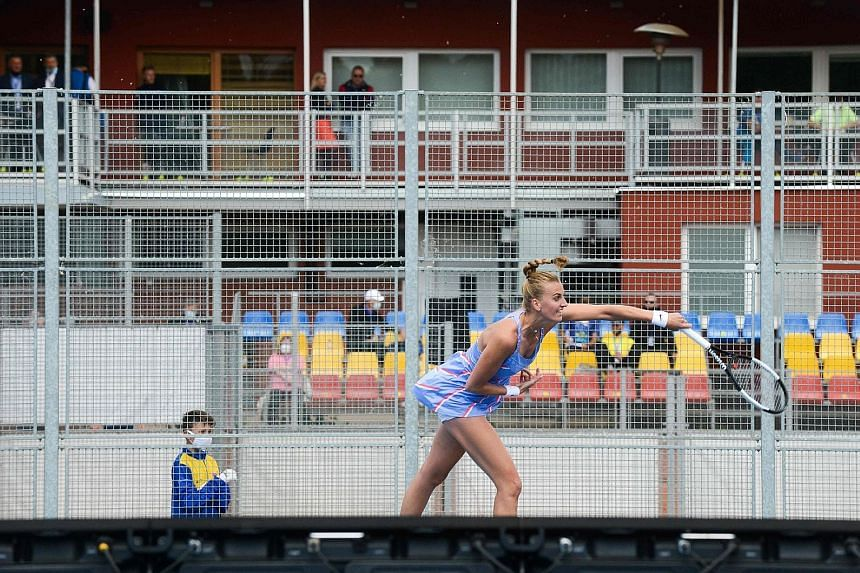 Petra Kvitova returning a shot to Barbora Krejcikova in an all-Czech exhibition match at the Sparta Prague tennis club. They were playing to raise funds for those affected by the coronavirus pandemic in the Czech Republic.