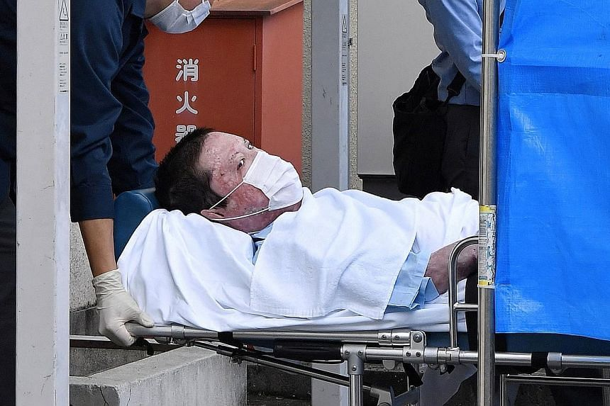 Suspect Shinji Aoba being taken to a police station in Kyoto yesterday, following his formal arrest over a fire that killed 36 people in the Japanese city last year. He could not be questioned earlier because he had suffered serious burns in the blaz