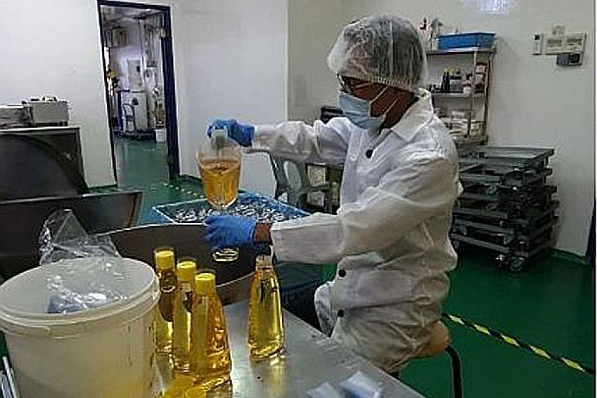 Mr Gordon Li, a customer service associate of logistics company UBTS, has been redeployed to baking goods retailer Phoon Huat's packaging factory. PHOTO: UBTS