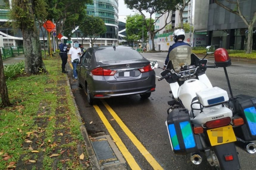 LTA officers conducting enforcement operations against illegal car-pooling services along Handy Road on April 22-23.
