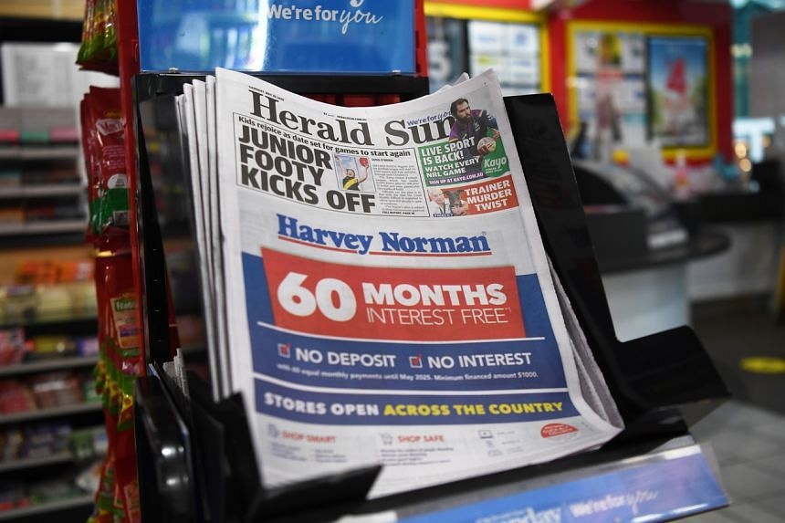 A Herald Sun newspaper is seen on a newsstand in Melbourne, Australia, on May 28, 2020.