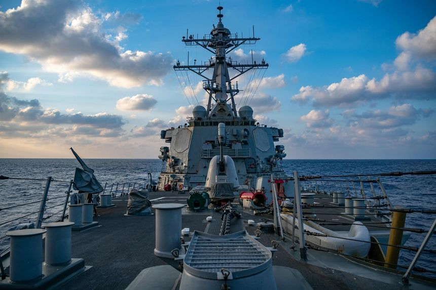 A photo from April 28, 2020, shows a US Navy guided-missile destroyer conducting underway operations in the South China Sea.