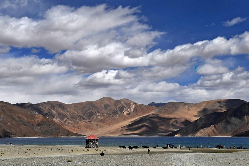 China has placed about 5,000 soldiers and armoured vehicles within its side of the disputed border in the Ladakh region.
