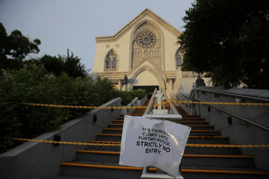 Closure notice in front of The Church of St Alphonsus, on May 13, 2020.