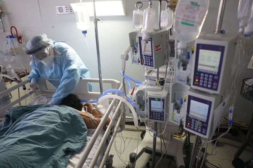 A health worker treats a Covid-19 patient attached to a life support machine, at a hospital in Mexico.