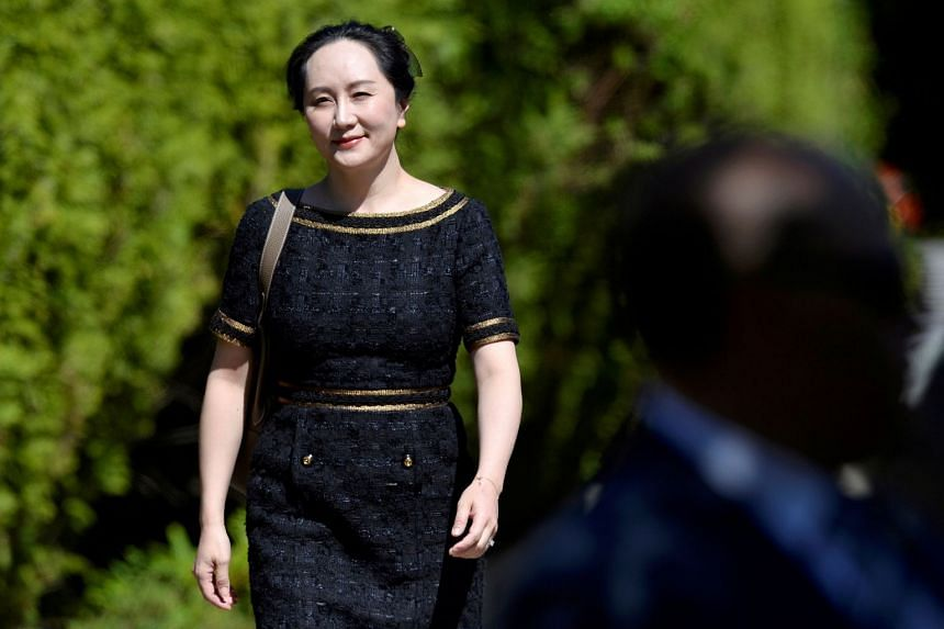 Meng Wanzhou leaves her home to attend a court hearing in Vancouver.