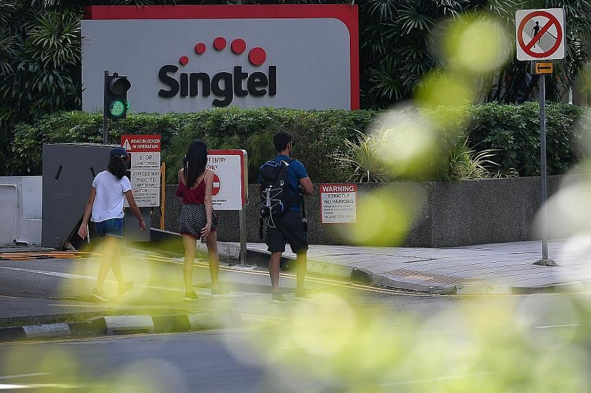 Singtel took a net exceptional charge of $302 million for the fourth quarter, mainly arising from India unit Bharti Airtel's provision for a one-time spectrum charge. ST FILE PHOTO