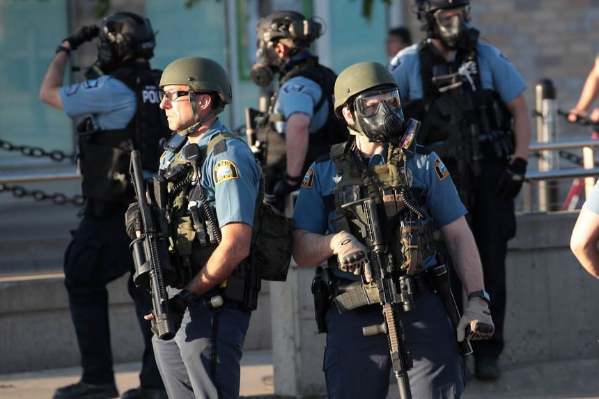 Police gather near a protest, on May 28, 2020, in St. Paul, Minnesota.