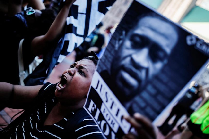 A protester gathers with others outside the city hall after George Floyd died in police custody in Minneapolis, Minnesota, on May 28, 2020.
