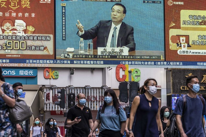 China's premier, Li Keqiang, is seen on an outdoor video screen in Hong Kong on May 28, 2020.