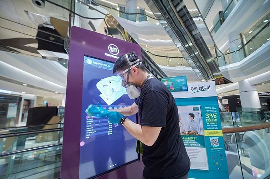 High-contact areas in CapitaLand malls, including Tampines Mall (above), will progressively be coated with an anti-microbial disinfectant.
