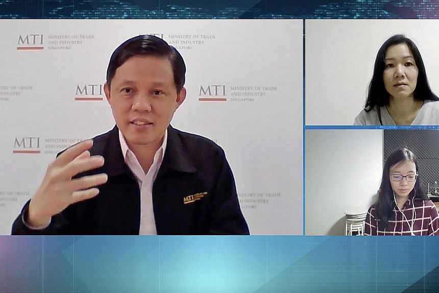 Trade and Industry Minister Chan Chun Sing speaking to The Straits Times' senior political correspondent Tham Yuen-C (top right) and manpower correspondent Joanna Seow in a video interview on Wednesday. PHOTO: SPH