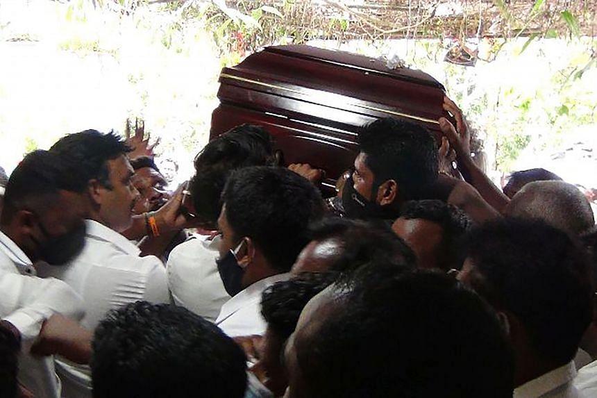 People carrying the coffin of Arumugam Thondaman in the central tea capital of Nuwara Eliya, Sri Lanka, on May 30, 2020.