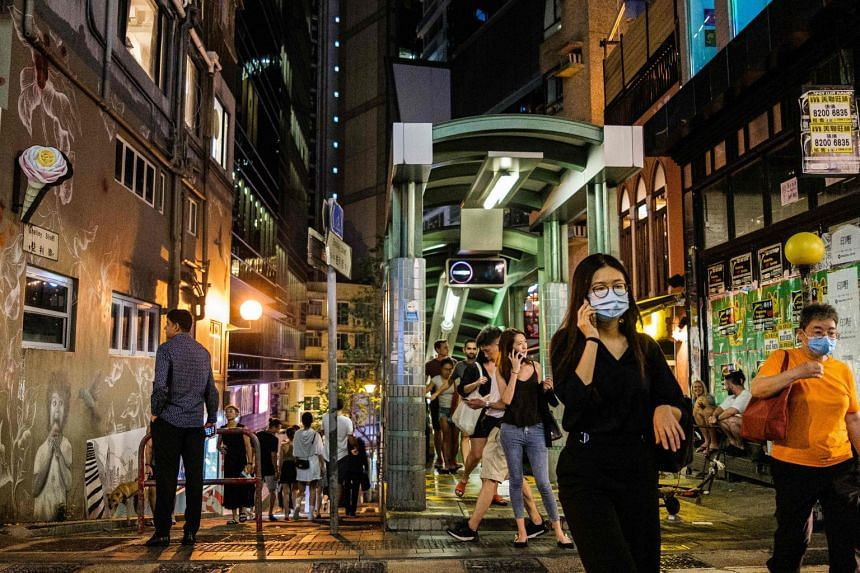Pedestrians walk through the Soho district of Hong Kong on May 29, 2020.