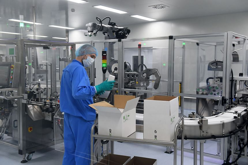 An employee at the production line of Russia's biotech company Biocad, which is developing its own Covid-19 vaccine.