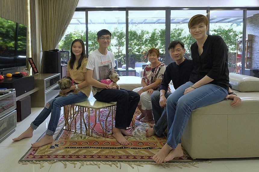 OneConnect's South-east Asia CEO Tan Bin Ru, 46, with her husband Low Chong Eng, 46, children Adelle, 18, and Bryan, 20, and mother-in-law Teo Ha, 73, in their home at The Interlace in Depot Road. Her unit is on the ground floor, with four bedrooms, a gen