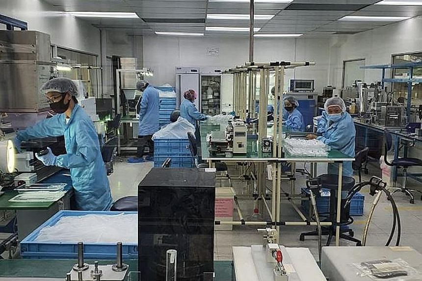 Medical device maker Racer Technology's chief executive Willy Koh says infection and exposure risks are actually lower when its employees are at work as about 70 per cent of its production staff work in clean rooms and are required to wear protective
