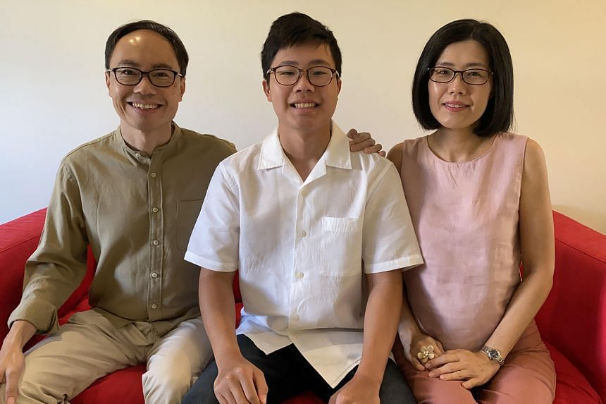 Mr Walter Lim (left, with son Ethan and wife Tina Tan) is a member of the Media Literacy Council. He believes in open communication with 16-year-old Ethan on online risks such as cyber bullying.