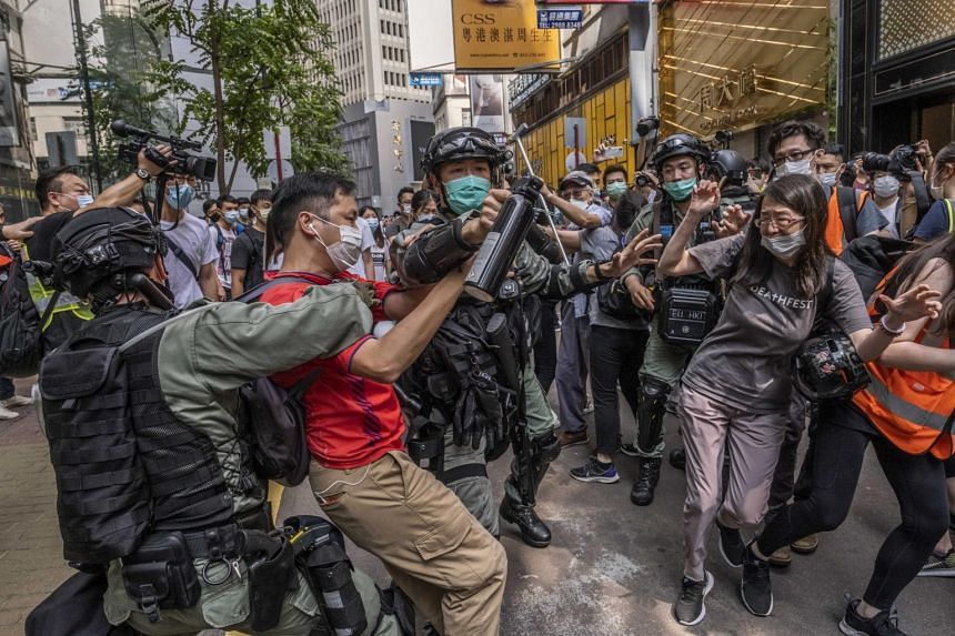 Riot police officers clash with protesters in Hong Kong on May 27, 2020.