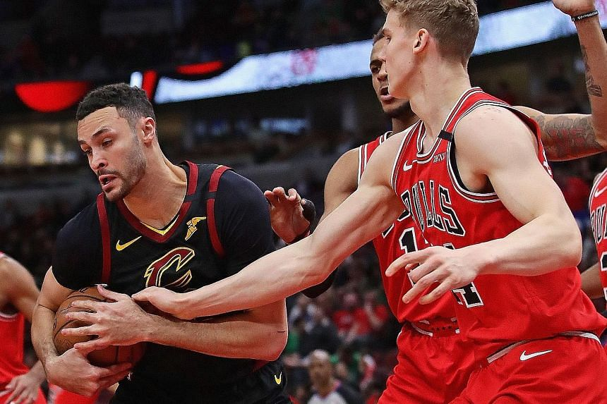 """Cleveland's Larry Nance Jr trying to keep the ball away from Lauri Markkanen of the Chicago Bulls at the United Centre on March 10, a day before the NBA suspended its season. The Cavaliers forward, 27, is """"scared"""" of making an NBA comeback during the coro"""