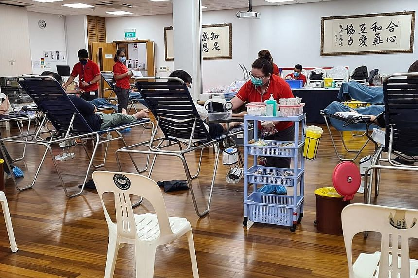 Donors at a community blood drive at the Tzu Chi Foundation last month. Currently, only four mobile drives are held each week compared with at least 10 such drives weekly in the past. PHOTO: SINGAPORE RED CROSS