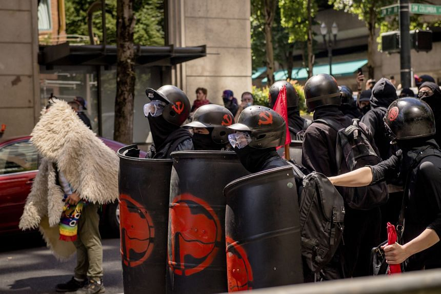 Protesters with antifa symbols on their shields in Portland, US, on Aug 4, 2018.