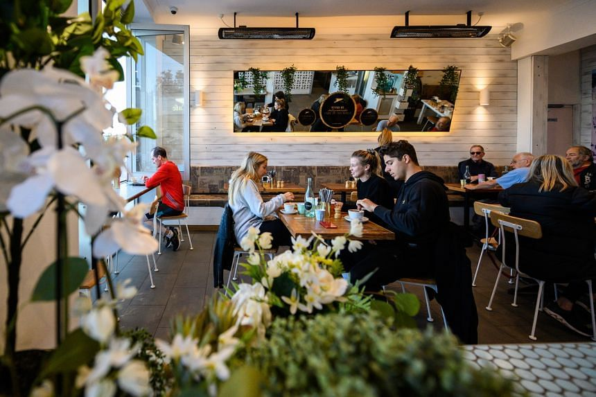 People dine at a cafe in Bondi Beach, Sydney, on June 1, 2020.