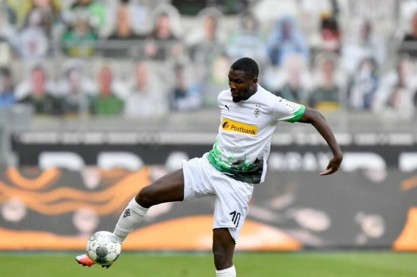 Bundesliga player Thuram takes a knee after scoring amid George Floyd protests
