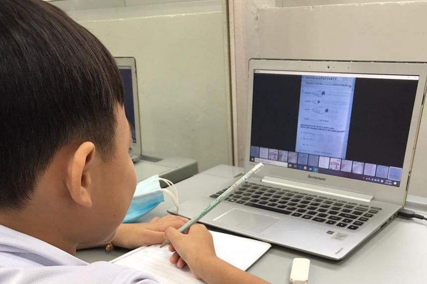 A child attends an online session of a reading programme by Shine Children and Youth Services and its partners.