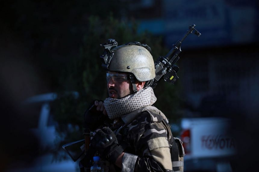 An Afghan security officer stands guard after an explosion in Kabul on May 30, 2020.