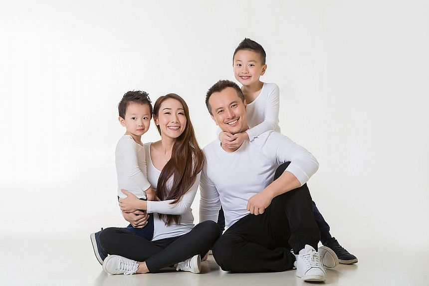 Children's author Robin Leong with his wife Kris Ruan and their two children, Brady (far left) and Lucas.