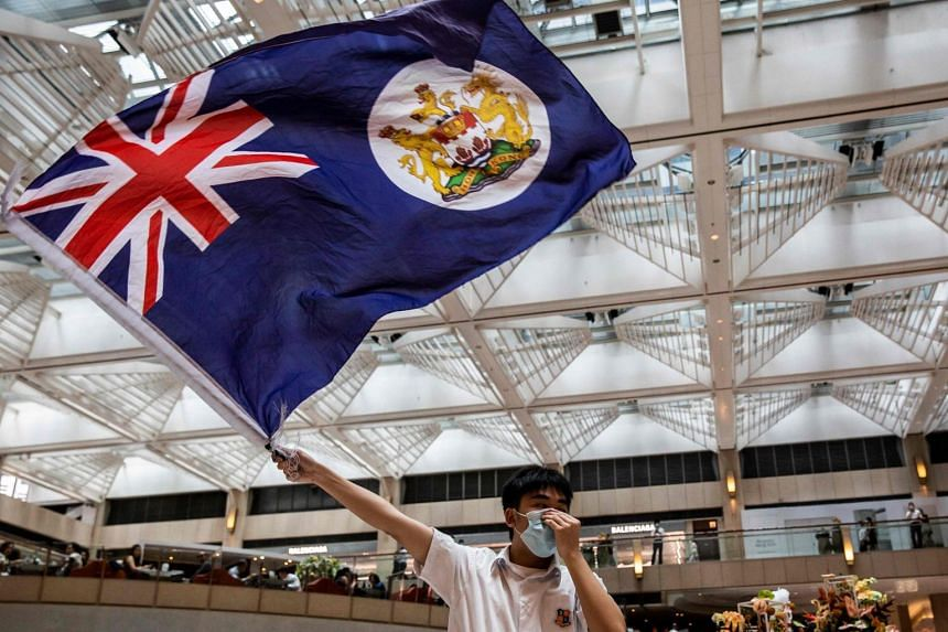 A pro-democracy protester waves a British colonial flag during a rally in Hong Kong on June 1, 2020.