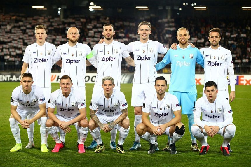 LASK Linz players pose for a team group photo in February 2020.