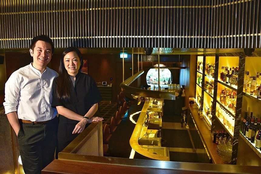 Mr Indra Kantono and his wife Gan Guoyi, founders of Jigger & Pony, at the bar's location at Amara Singapore hotel. Mr Kantono says a combination of rental waivers and the Jobs Support Scheme enabled him to retain all local staff without cutting thei