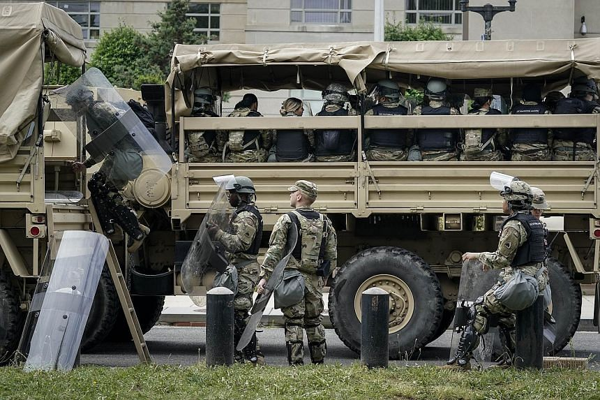 Troops boarding personnel carriers on Tuesday to take them towards the capital Washington from the Joint Force Headquarters of the District of Columbia National Guard.