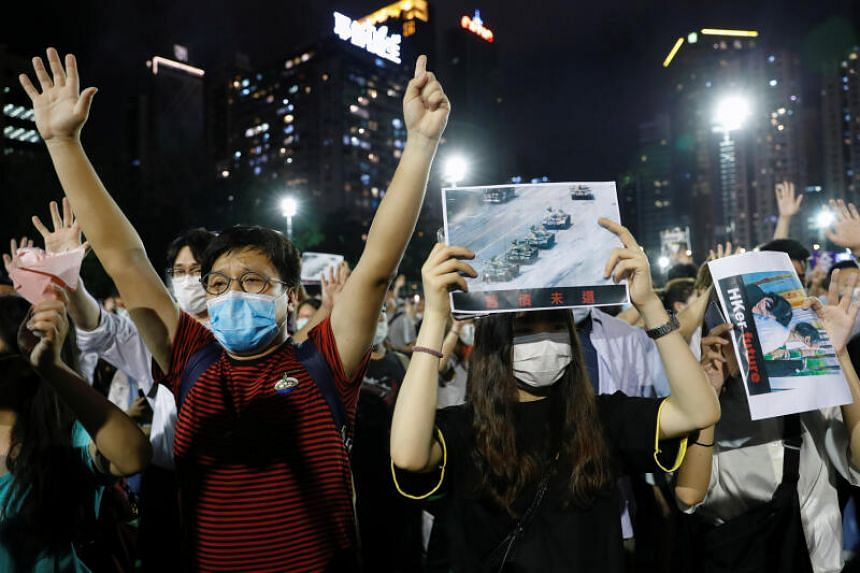 Protesters take part in a vigil to mark the 31st anniversary the Tiananmen Square incident, in Hong Kong, June 4, 2020.