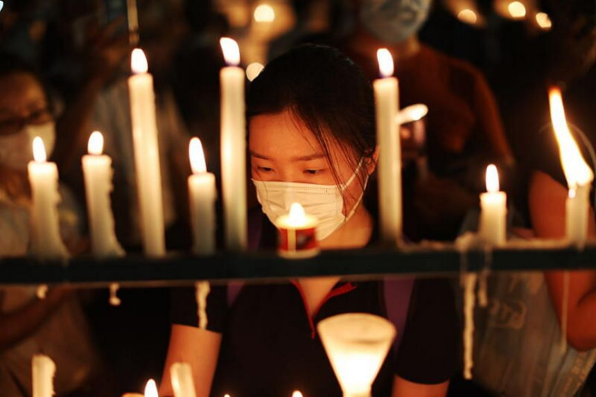 A woman attends a candlelit vigil to commemorate the Tiananmen Square anniversary in Hong Kong, on June 4, 2020.