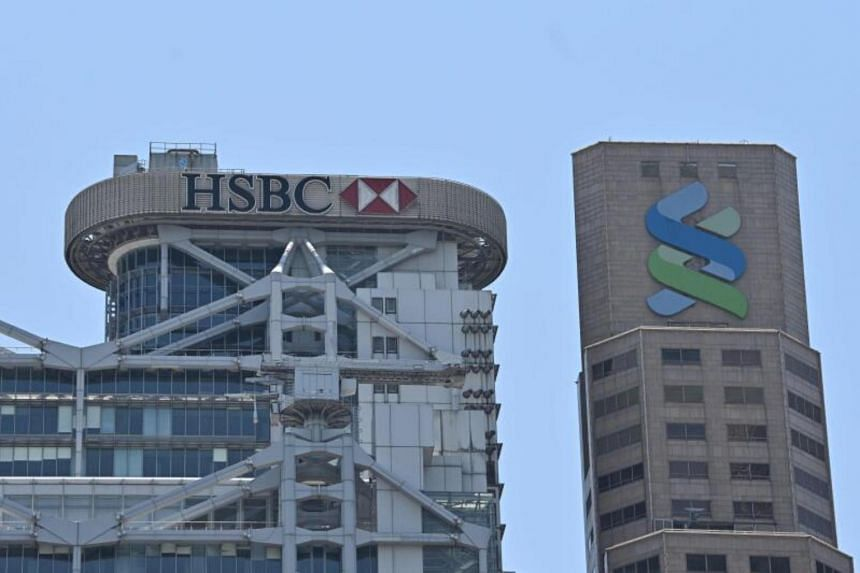 """HSBC and Standard Chartered endorsed a Chinese proposal that critics say will diminish freedom and violate the """"one country, two systems"""" principle."""