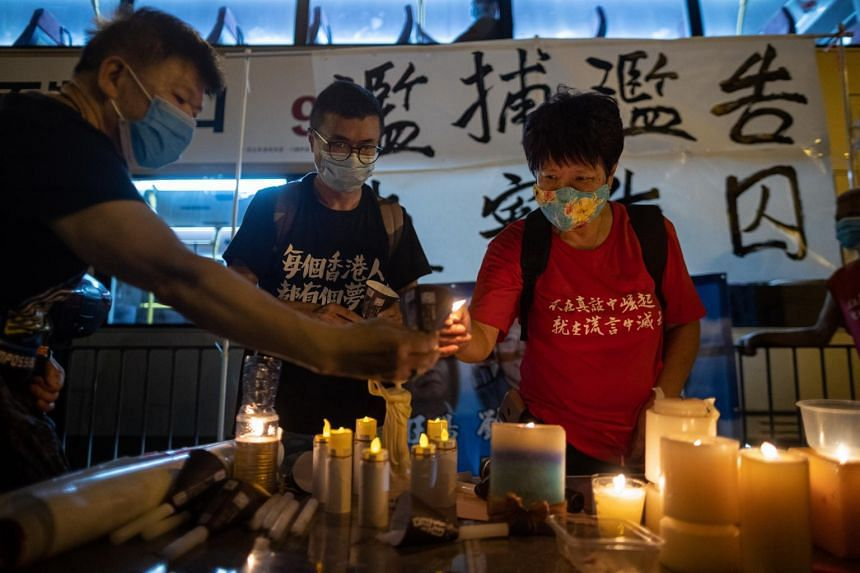 Pro-democracy activists light up candles on the eve of the Beijing Tiananmen Massacre anniversary in Hong Kong on June 3, 2020.