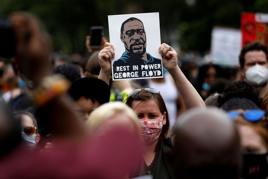 People attend a public memorial after the death in Minneapolis police custody of George Floyd.